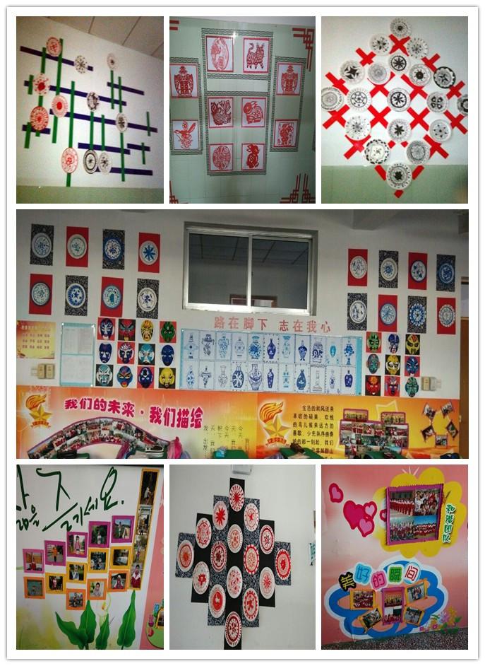 还有教室外墙上的展示墙,上面贴满了同学们自己绘制的青花瓷,脸谱